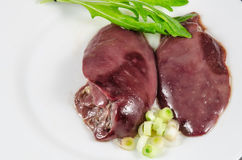 Raw chicken liver with vegetables Royalty Free Stock Photography