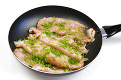 Raw chicken meat. On a frying pan ready for a frying Stock Photos