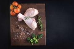Raw chicken meat. Raw chicken drumsticks on dark background with blank space Stock Photo