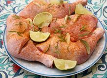 Raw chicken meat with rosemary. Some raw chicken meat with rosemary and lemon Stock Image