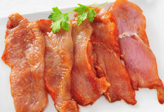 Raw chicken meat. Some slices of raw chicken meat marinated with paprika and olive oil in a plate Royalty Free Stock Photography