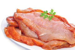 Raw chicken meat. Some slices of raw chicken meat marinated with paprika and olive oil in a plate Stock Photography