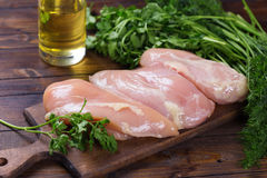 Raw  chicken meat  on wooden table Stock Photography