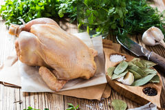 Raw chicken onwooden background, organic food, diet or cooking c Stock Photo