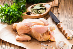 Raw chicken onwooden background, organic food, diet or cooking c Royalty Free Stock Image