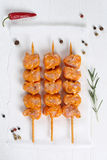 Raw chicken ot turkey meat skewers from above. On a wooden table Stock Photos