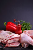 Raw chicken and pork with pepper and parsley Royalty Free Stock Photography
