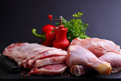 Raw chicken and pork with pepper and parsley Stock Image