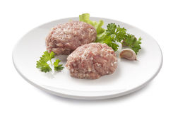 Raw chicken rissoles Stock Images