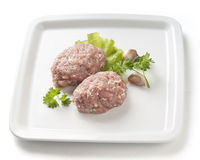 Raw chicken rissoles Royalty Free Stock Photos