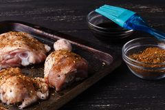 Raw chicken with rose pepper and thyme stock photos
