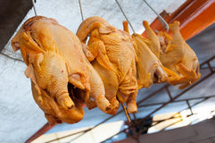 Raw Chicken for Sale. Hanging on Hooks Raw Chickens for Sale in the Street Market Royalty Free Stock Image