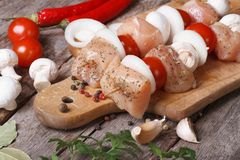 Raw chicken shish kebab with mushrooms, tomatoes and onions Stock Photo