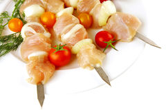 Raw chicken shish kebab Stock Images