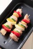 Raw chicken shish kebabs Stock Photography
