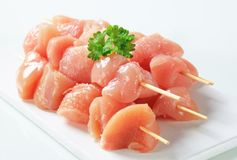 Raw chicken skewers. On cutting board Stock Photography