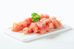 Raw chicken skewers. On cutting board royalty free stock images