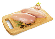 Raw chicken, spices and  wooden board isolated on white background. Royalty Free Stock Photo