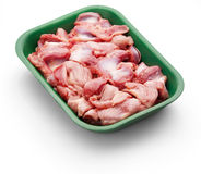 Raw chicken stomach in a green tray over white background. Studio shoot Stock Photos