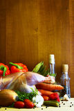 Raw chicken surrounded by vegetables Stock Photo