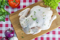 Raw chicken on table Royalty Free Stock Photos