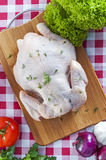 Raw chicken on table. Raw chicken on wooden board Royalty Free Stock Photos