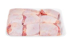 Raw chicken thigh. On white background royalty free stock images