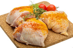 Raw chicken thigh Stock Photos