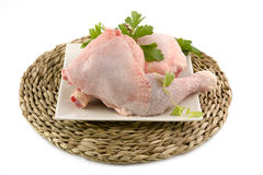 Raw chicken thighs or legs, pieces isolated background Stock Photo