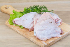 Raw chicken thighs Stock Images