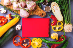 Raw chicken thighs with various vegetables ingredients. Top view Royalty Free Stock Photography