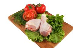 Raw chicken thighs with vegetables Royalty Free Stock Photo