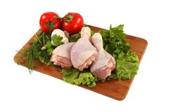 Raw chicken thighs with vegetables Stock Images