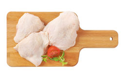 Raw chicken thighs. On wooden cutting board Stock Image