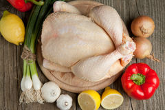 Raw chicken with vegetables Stock Images