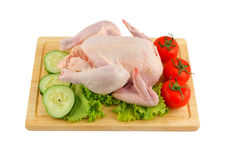 Raw chicken with vegetables on chopping board Royalty Free Stock Photography