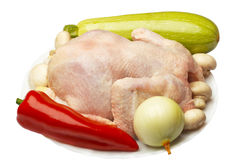 Raw chicken and vegetables Stock Photos