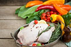 Raw chicken with vegetables and spices ready to fry, chicken. Raw chicken with vegetables and spices ready for frying, chicken in a brazier stuffed with Stock Photos