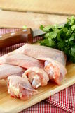 Raw chicken wings. On a cutting board Stock Photo