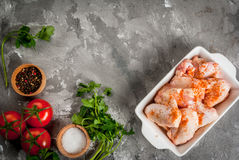 Raw chicken wings in a baking dish Royalty Free Stock Photos