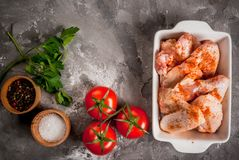 Raw chicken wings in a baking dish Stock Photo