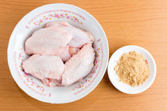 Raw chicken wings in bowl on wooden table ,Top view.  Stock Image