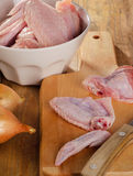Raw chicken wings on a chopping board Stock Photos
