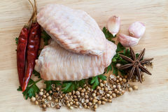 Raw chicken wings on chopping board Royalty Free Stock Photo