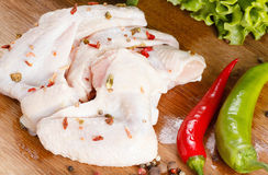 Raw chicken wings. On cutting board. Cooking food Stock Images