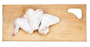 Raw chicken wings. On cutting board isolated on white background Royalty Free Stock Photography