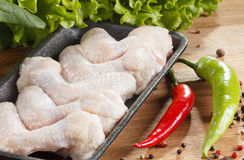 Raw chicken wings. In disposable packaging. Cooking food Royalty Free Stock Photo