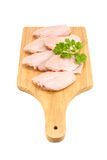 Raw chicken wings. With green coriander on a cutting board isolated on white background Stock Images