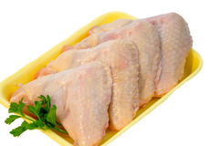 Raw chicken wings. With green salad, high angle view, clipping path included Royalty Free Stock Photos