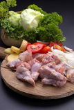 Raw chicken wings and ingredients for cooking on black backgroun Royalty Free Stock Photo